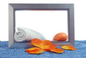 Soaps and blue towel — Stock Photo