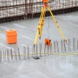 Equipment theodolite tool at construction site - Stock Photo