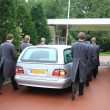 Grey hearse entering cemetery — Stock Photo