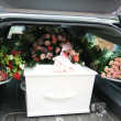 White coffin in a grey hearse — Stock Photo
