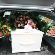 Stock Photo: White coffin in a grey hearse