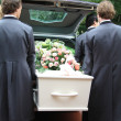 Royalty-Free Stock Photo: White casket taken out of a grey hearse