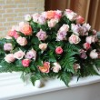 White coffin with pink sympathy flowers — Stock Photo #7546585