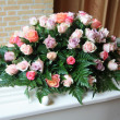 White coffin with pink sympathy flowers — Stockfoto #7546585
