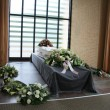 White coffin with sympathy flowers — Stock Photo #7546619