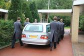 Grey hearse entering cemetery — Stock Photo