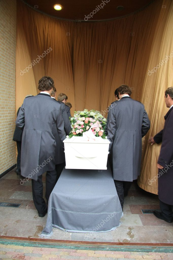 Funeral home employees preparing a casket for a funeral service  Stock Photo #7546519
