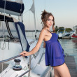 The charming beauty poses at the yacht - Stock Photo