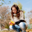 Girl with yellow leaves — Stock Photo #7570106