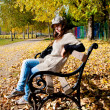 Girl sitting in the park — Stock Photo #7570276