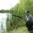 Hunter with shotgun — Stockfoto #6802136