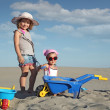 Two little girl fun and play in sand — Stock Photo