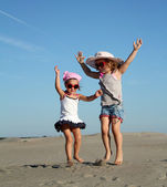 Two little girl fun and jumping — Stock Photo