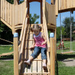 Little girl fun on wooden playground — Stock Photo