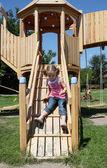 Little girl fun on wooden playground — Stock Photo