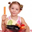 Beauty little girl with vegetables — Stock Photo