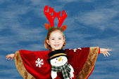 Beautiful little girl with deer Rudolf horn on head — Stock Photo