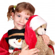 Little girl holding teddy-bear Santa Claus — Stock Photo