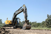 Excavator on road construction — Foto Stock