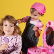 Royalty-Free Stock Photo: Little girls play hairdressers