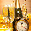 Happy New Year - Champagne and clock — Stock Photo