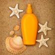 Summer beach - suntan oil — Stock fotografie