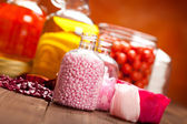 Pink bath salt and oils — Stock Photo