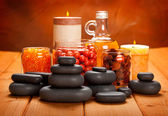 Spa supplies - essential oil, bath salt and massage stones — Stock Photo