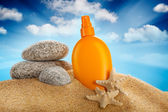 Sunbath - suntan oil — Stock Photo