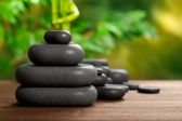Spa stones on green background — Stock Photo