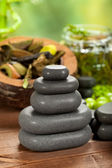 Spa treatment - black stones — Stock Photo