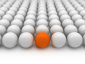 Individuality - gray and orange balls — Stock Photo