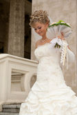 The beautiful bride with a bouquet — Stock Photo