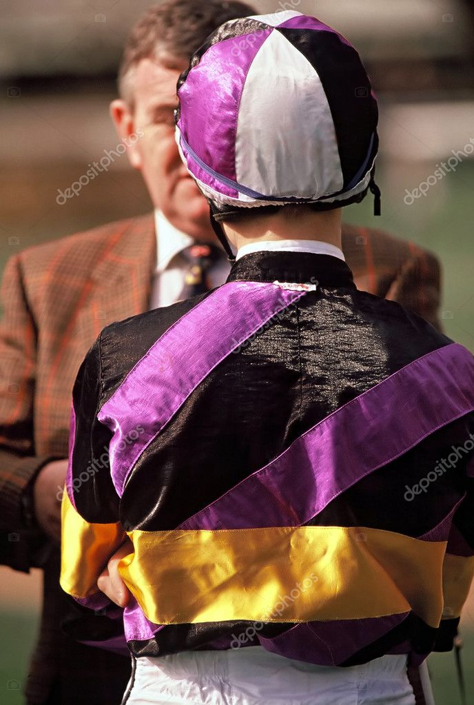 A jockey on raceday talking to a horse trainer pre race — Stock Photo #6939121