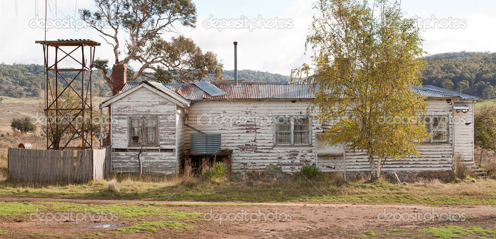 Old abandoned weatherboard farmhouse, rural Australia  Stock Photo #7829634