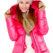 Young woman wearing winter jacket scarf and cap — Stock Photo