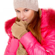Stock Photo: Young woman wearing winter jacket scarf and cap