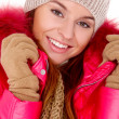 Young woman wearing winter jacket scarf and cap — Stock Photo #7724015