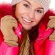 Royalty-Free Stock Photo: Young woman wearing winter jacket scarf and cap
