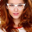 Stock Photo: Portraif of young woman wearing glasses on white