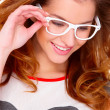 Portraif of young woman wearing glasses on white — Stock Photo
