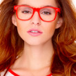 Stock Photo: Portraif of young womwearing glasses on white