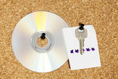 Key with note and CD — Stock Photo