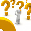Confused man and question marks — Stock Photo