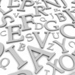 Black and white letters background — Stock Photo #7860045