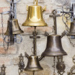 Royalty-Free Stock Photo: Bells on wall.