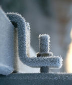 Ice crystals on frozen nut and bolt in winter — Stock Photo