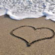 Stock Photo: Heart - drawn in sand