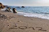 2012 write in the sand on beach — Stock Photo