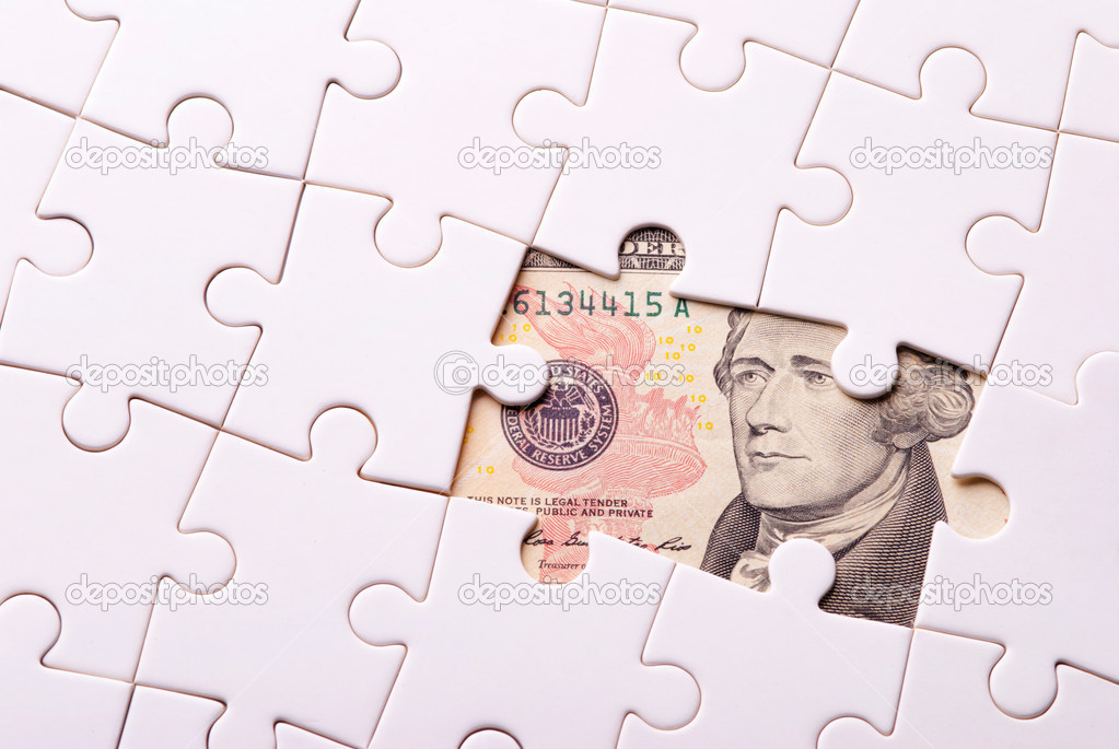 Finance concept. Find out wealth from the puzzle game. — Stock Photo #7499430